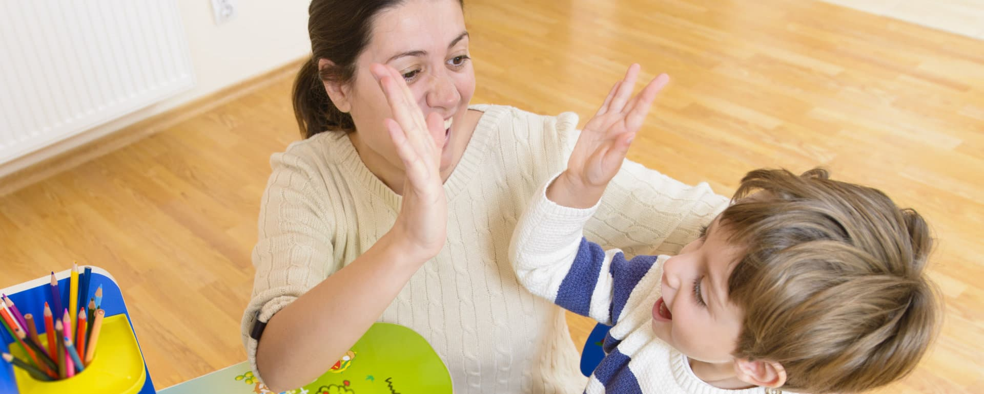 teacher with her student having a high five