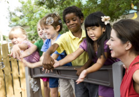 Diverse group of preschool 5 year old children playing in daycare