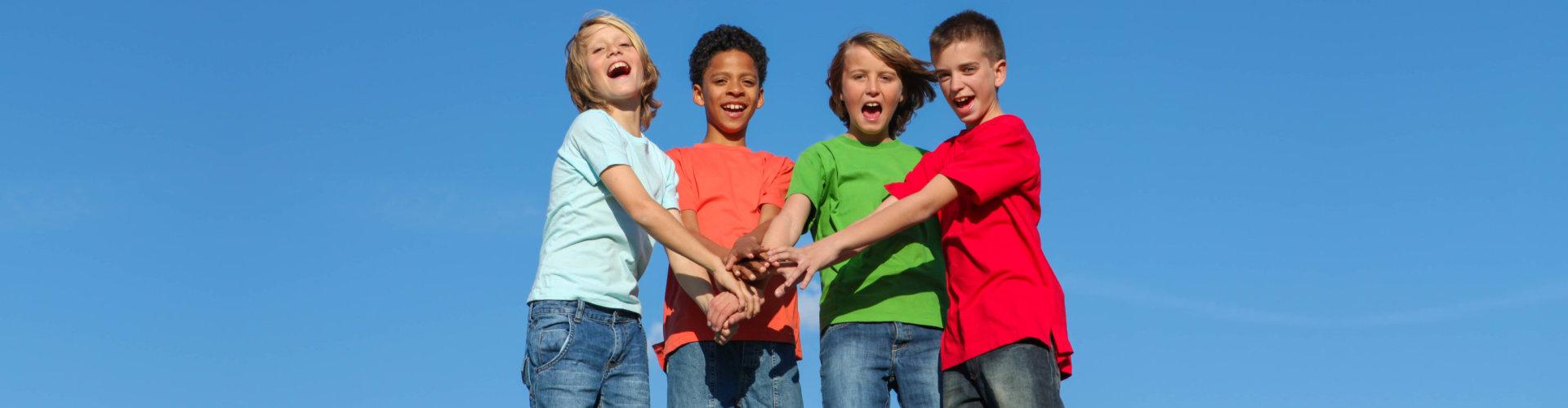 Group of diverse kids or teens hands together